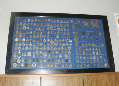 Framed collection of military badges