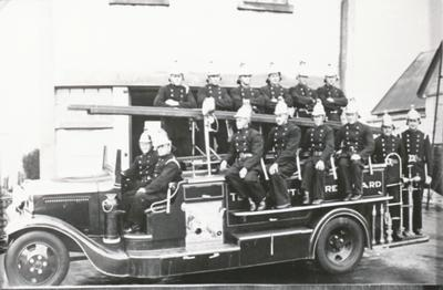 Firemen on Old Fire Engine