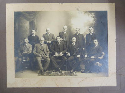 Black and white photograph of 10 men.